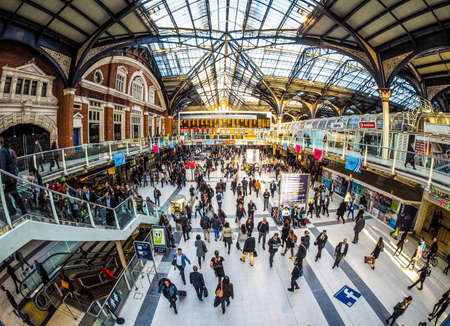 LONDON, UK - SEPTEMBER 28, 2015: Travellers at Liverpool Street Station seen with fisheye lens (HDR) Editorial