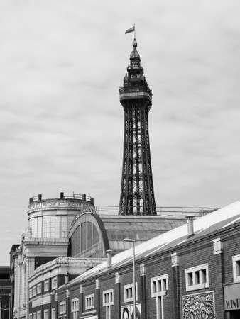 amusement park black and white: BLACKPOOL, UK - CIRCA JUNE 2016: Blackpool Tower on Blackpool Pleasure Beach resort amusement park on the Fylde coast in black and white