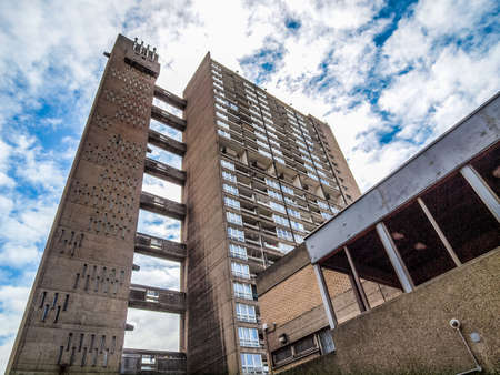 listed: LONDON, ENGLAND, UK - JUNE 20, 2011: The Balfron Tower designed by Erno Goldfinger in 1963 is a Grade II listed masterpiece of new brutalist architecture (HDR)