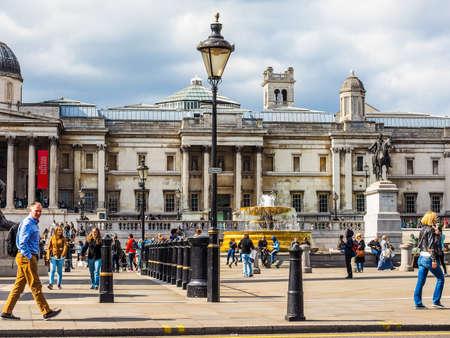 trafalgar: LONDON, UK - JUNE 09, 2015: Tourists visiting Trafalgar Square in front of the National Gallery (HDR) Editorial