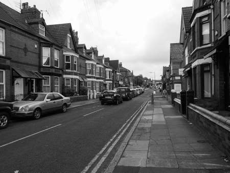 the beatles: LIVERPOOL, UK - CIRCA JUNE 2016: Penny Lane made famous by The Beatles song Penny Lane on their 1967 album Magical Mystery Tour in black and white