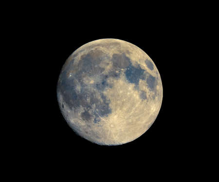 astrophoto: Full moon seen with an astronomical telescope, with enhanced colours to show the real colours of terrain surface