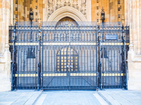 sovereign: High dynamic range HDR Houses of Parliament Westminster Palace London gothic architecture - Sovereign entrance gate Editorial