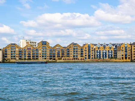 High dynamic range HDR Docks in London Docklands on River Thames, UK Stock Photo