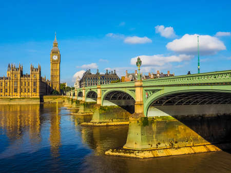 High dynamic range HDR Westminster Bridge over River Thames with Houses of Parliament and Big Ben in London, UK