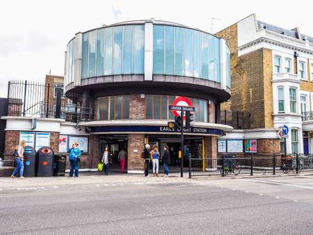 earls court: LONDON, UK - SEPTEMBER 27, 2015: Travellers at Earls Court London Underground tube station (HDR)