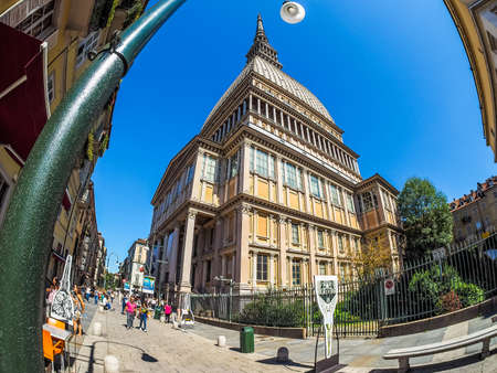 TURIN, ITALY - CIRCA SEPTEMBER, 2015: Tourists visiting the Mole Antonelliana which is the highest building in town seen with fisheye lens (HDR)