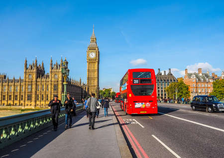 LONDON, UK - SEPTEMBER 28, 2015: Tourists on Westminster Bridge at the Houses of Parliament aka Westminster Palace (HDR) Editorial