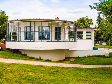 carl: DESSAU, GERMANY - JUNE 13, 2014: Kornhaus meaning Granary is a restaurant designed by Carl Fieger in 1929 on the river Elbe in Dessau Rosslauer belonging to the Bauhaus (HDR)