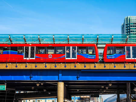 docklands: LONDON, UK - JUNE 11, 2015: The DLR meaning Docklands Light Railway links the docks redevelopment area in East London with the city centre (HDR)