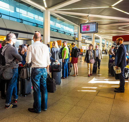 queueing: BERLIN, GERMANY - CIRCA JUNE 2016: People queueing at Berlin Tegel airport waiting for checkin (HDR)