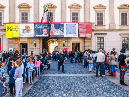 queueing: MILAN, ITALY - APRIL 10, 2014: People queueing in front of Palazzo Reale exhibition room to visit a temporary exhibition (HDR) Editorial