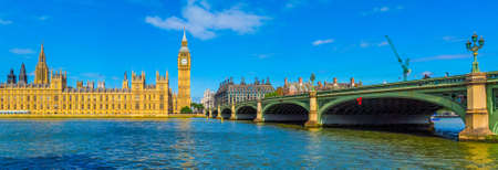 westminster bridge: LONDON, UK - JUNE 10, 2015: High resolution panoramic view of the Houses of Parliament Big Ben and Westminster Bridge seen from river Thames (HDR)