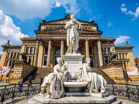 BERLIN, GERMANY - CIRCA JUNE 2016: Friedrich Schiller monument in front of Konzerthaus Berlin concert hall on the Gendarmenmarkt square in central Mitte district (HDR)