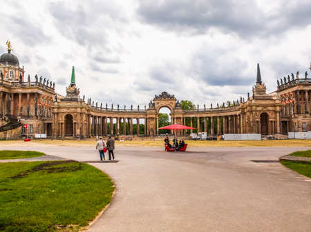 palais: POTSDAM, GERMANY - MAY 10, 2014: Tourists visiting the ruins of the Neues Palais new royal palace in Park Sanssouci (HDR)