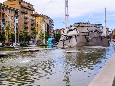 public space: TURIN, ITALY - MAY 08, 2007: The igloo fountain by famous Italian artist Mario Merz is his first artwork installed outdoor in a public space in his home town (HDR)