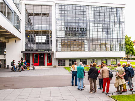 guided: DESSAU, GERMANY - JUNE 13, 2014: Visitors on an official guided tour of the Bauhaus building (HDR)