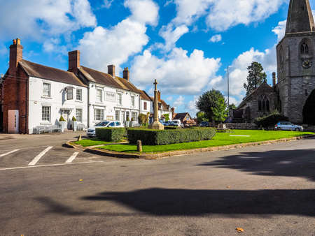 arden: TANWORTH IN ARDEN, UK - SEPTEMBER 25, 2015: The Village Green with The Bell pub (HDR) Editorial
