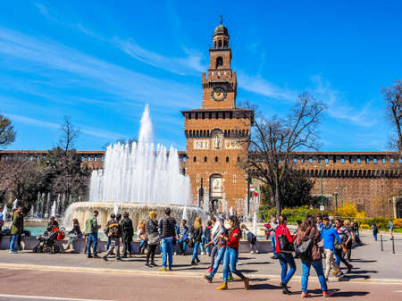 sforza: MILAN, ITALY - MARCH 28, 2015: People visiting the Sforza Castle aka Castello Sforzesco which is the oldest castle in town (HDR) Editorial
