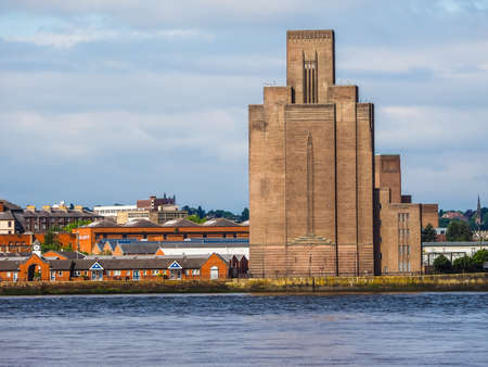 across: High dynamic range (HDR) View of Birkenhead skyline across the Mersey river in Liverpool, UK