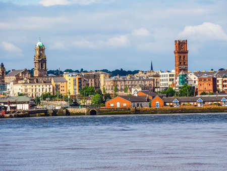 mersey: High dynamic range (HDR) View of Birkenhead skyline across the Mersey river in Liverpool, UK