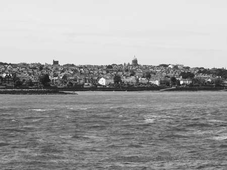 lancashire: View of Birkenhead skyline across the Mersey river in Liverpool, UK in black and white