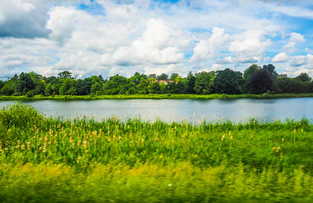 range of motion: High dynamic range (HDR) English countryside seen from a train to London, with selective focus on the horizon and motion blur on the foreground
