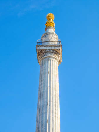 High dynamic range HDR The Monument to commemorate the Great Fire of London in 1666 - over blue sky background Stock Photo