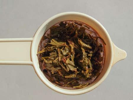gunpowder: LONDON, UK - CIRCA AUGUST 2016: Chinese gunpowder green tea in a colander