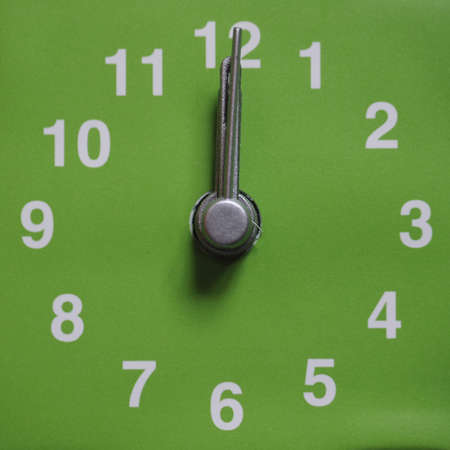 Clock showing time - 12 twelve o clock, midnight or noon Stock Photo