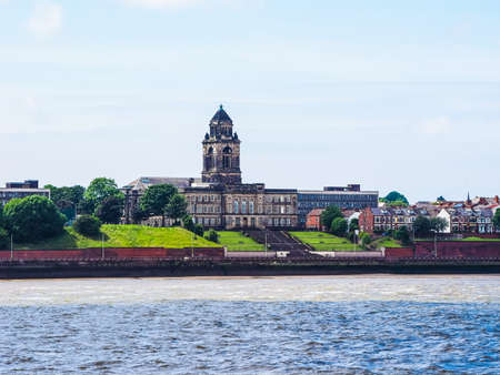 High dynamic range (HDR) View of Birkenhead skyline across the Mersey river in Liverpool, UK