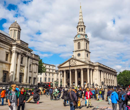 trafalgar: LONDON, UK - JUNE 09, 2015: Tourists in front of the Church of Saint Martin in the Fields in Trafalgar Square (HDR) Editorial