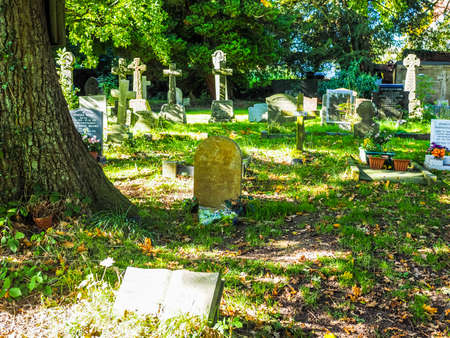 TANWORTH IN ARDEN, UK - SEPTEMBER 25, 2015: Grave of English musician Nick Drake in the churchyard of St Mary Magdalene church (HDR)