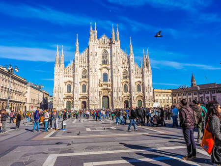 MILAN, ITALY - MARCH 28, 2015: Tourists in the Piazza Duomo square in front of Milan Cathedral church (HDR)