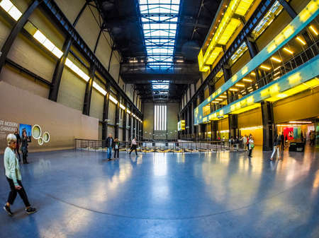south space: LONDON, UK - SEPTEMBER 28, 2015: The Turbine Hall once housed the electricity generators of the power station now a public space part of Tate Modern art gallery in South Bank seen with fisheye lens (HDR)