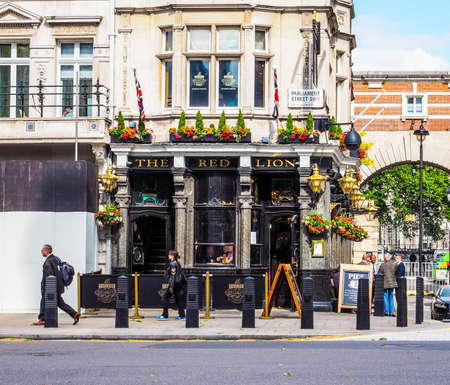 elite: LONDON, UK - JUNE 09, 2015: The Red Lion pub situated in London political heart near the Houses of Parliament has been the favoured pub of the political elite for centuries (HDR)