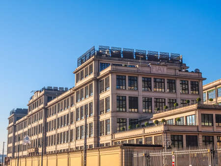 rationalist: TURIN, ITALY - JANUARY 24, 2014: The Fiat Lingotto car factory designed by Trucco in 1916 was the largest car factory at the time and still houses the Fiat directional centre and an exhibition complex (HDR)