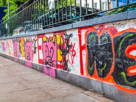 LONDON, ENGLAND, UK - JUNE 18, 2011: Graffiti by Beatles fans on the wall of the Abbey Road studios where the homonymous album was recorded in 1969 (HDR) Editorial