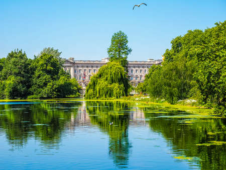 buckingham palace: LONDON, UK - JUNE 11, 2015: St James Park with Buckingham Palace in the background (HDR)