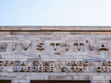 tribunal: MILAN, ITALY - APRIL 10, 2014: Ivstitia meaning Justice written in front of Milan tribunal court designed by Marcello Piacentini (HDR) Editorial