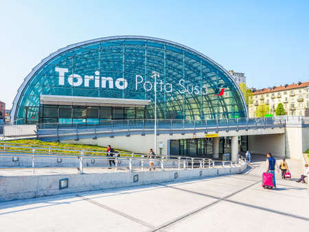 subway entrance: TURIN, ITALY - APRIL 11, 2015: The new Torino Porta Susa station is the main railway and subway station in town. Travellers in front of the main entrance. (HDR) Editorial