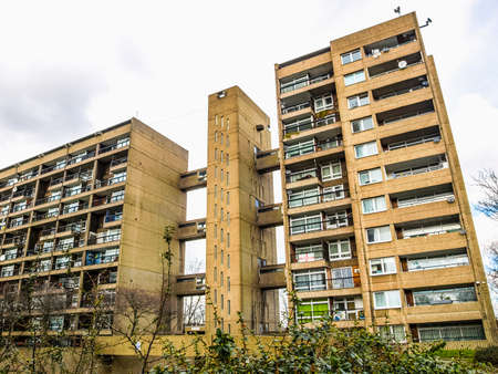 listed: LONDON, ENGLAND, UK - MARCH 05, 2009: The Balfron Tower designed by Erno Goldfinger in 1963 is a Grade II listed masterpiece of new brutalist architecture (HDR)