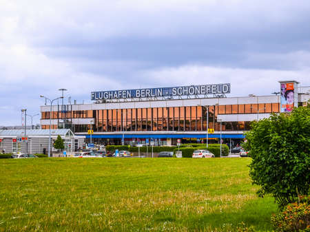 largest: BERLIN, GERMANY - MAY 12, 2014: The Schoenefeld international airport is the second largest Berlin airport after Tegel,flight (HDR)