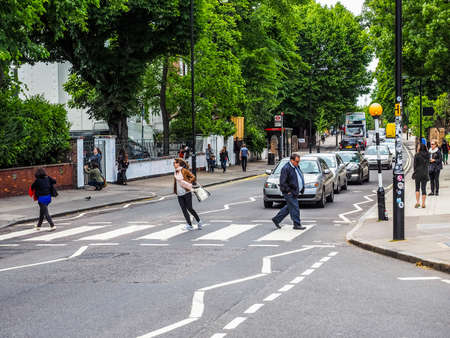 the beatles: LONDON, UK - JUNE 10, 2015: Abbey Road zebra crossing made famous by the 1969 Beatles album cover (HDR) Editorial
