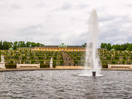 POTSDAM, GERMANY - MAY 10, 2014: Tourists visiting the baroque Schloss Sanssouci former summer palace of Frederick the Great King of Prussia (HDR)