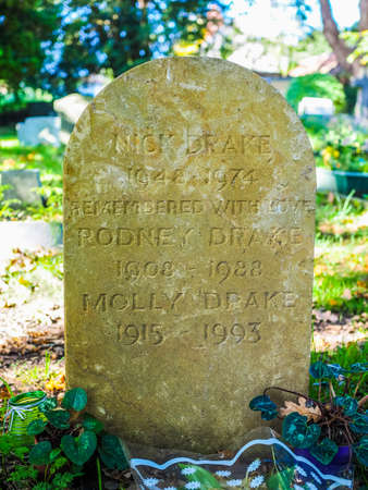 churchyard: TANWORTH IN ARDEN, UK - SEPTEMBER 25, 2015: Grave of English musician Nick Drake in the churchyard of St Mary Magdalene church (HDR)