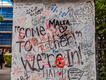 recorded: LONDON, ENGLAND, UK - JUNE 18, 2011: Graffiti by Beatles fans on the wall of the Abbey Road studios where the homonymous album was recorded in 1969 (HDR) Editorial