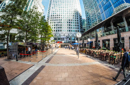 LONDON, UK - SEPTEMBER 29, 2015: The Canary Wharf business centre is the largest business district in the United Kingdom seen with fisheye lens (HDR) Editorial