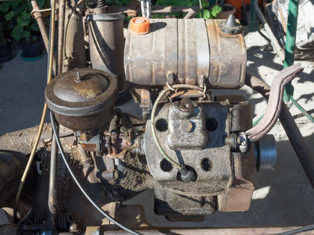 carburettor: MILAN, ITALY - CIRCA AUGUST 2016: Detail of Guidetti Condor engine on a vintage BCS 622 lawn mower