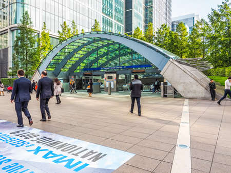 serves: LONDON, UK - SEPTEMBER 29, 2015: The Canary Wharf tube station serves the largest business district in the United Kingdom (HDR)